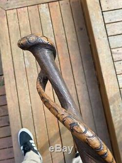 A Spectacular Old Australian Aboriginal Snake Entwined Carved Walking Stick