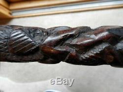 ANTIQUE TRIBAL HAND CARVED HARDWOOD WALKING STICK / CANE ITS HEAVY AND 98cm
