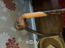 An Ian Taylor Curlew topped walking cane, length 125cm