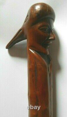 Antique English hand carved wooden walking stick plague mask faces with text