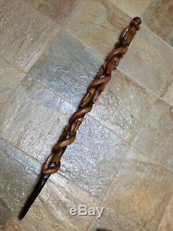 Antique Vintage Hand Carved Tribal Cane Walking Stick Multiple Faces & Snake