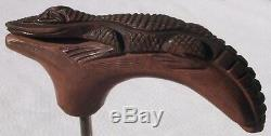 Carved wooden alligator that was made to be a handle for a walking stick