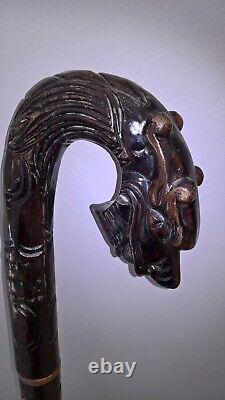 Chinese carved hardwood dragon walking stick with brass base lovely item