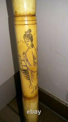 Chinese walking stick ornately carved solid and sturdy very functional