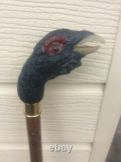 Rams horn walking stick carved cappercalie on a hazel shank with brass coller an