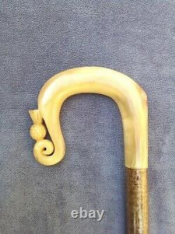 Rams horn walking stick or shepherds crook with scroll and thistle carving